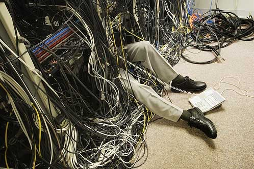 buried by cables on a messy data center
